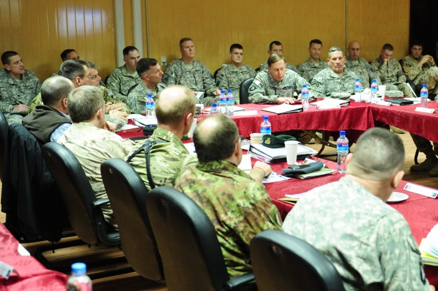 Gen. David H. Petraeus, commanding general of International Security Assistance Force and U.S. Forces Afghanistan, addresses the Regional Support Commanders Conference attendees Feb. 2, flanked by Lt. Gen. William B. Caldwell IV (left), commanding general of NATO Training Mission-Afghanistan/Combined Security Transition Command - Afghanistan and Command Sgt. Maj. Ralph R. Beam (right), same unit, at Camp Eggers, Kabul, Afghanistan.