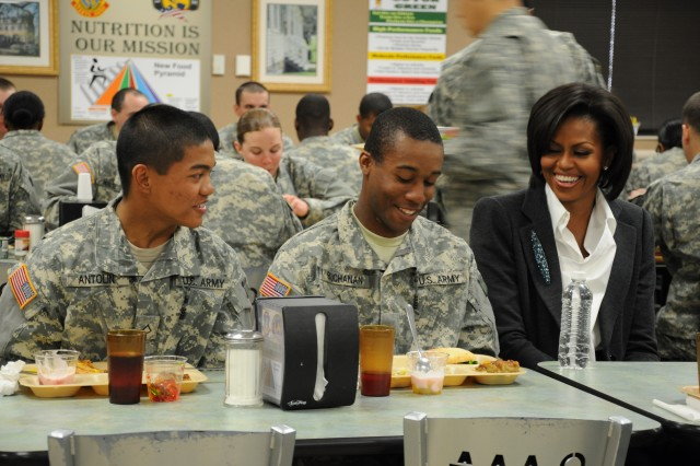 First Lady Michelle Obama shares a light moment with Pfc. Kevin Antolin, left, and Pvt. Rudolph Buchanan, both with the 2nd Battalion, 39th Infantry Regiment, during her visit to Fort Jackson Jan. 27. Obama met with drill sergeants and Soldiers-in-training at the battalion's dining facility.