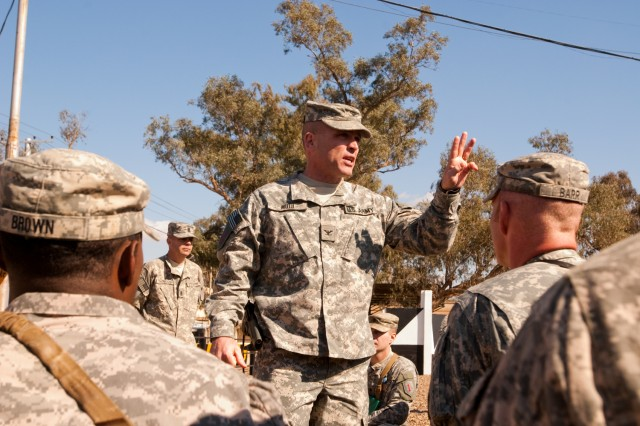 Col. Frank Muth, commander of the Enhanced Combat Aviation Brigade, 1st Infantry Division, speaks to a group of Soldiers after an end of tour award ceremony on Camp Taji, Iraq, Feb. 1. U.S. Army photo by Spc. Roland Hale, eCAB, 1st Inf. Div., PAO