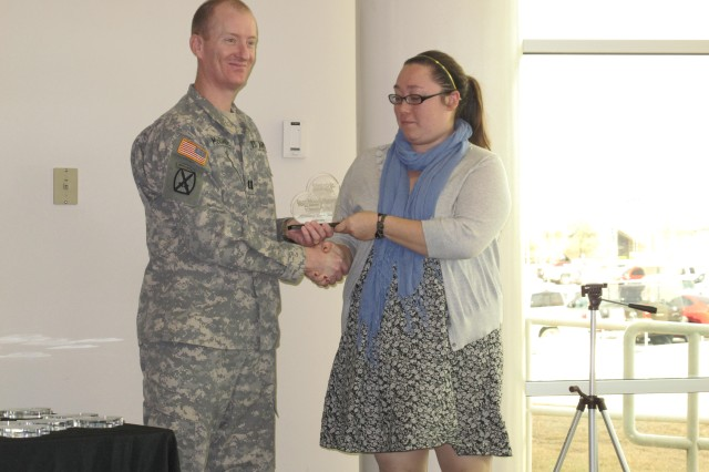 "Cpt. Steven McDaniel presents a ""Friend of the Blood Bank"" award to Amanda Stairett of the Killeen Daily Herald at the Robertson Blood Center at Fort Hood on January 26, 2011."