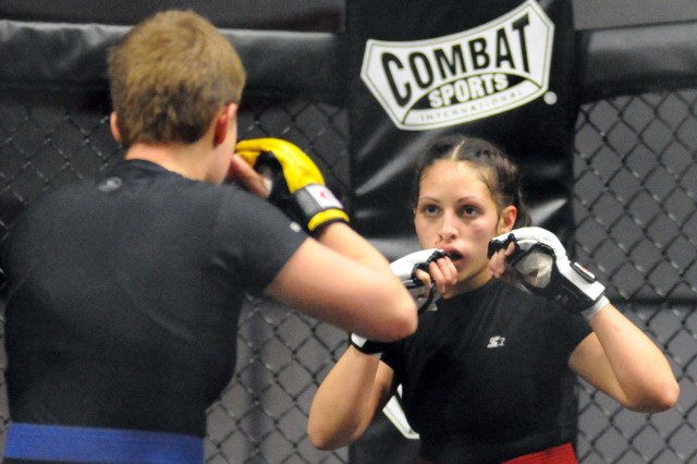 In the opening bout Jan. 28 at Abrams gym, Spc. Yazmary Gonzalez, 2nd Chemical Battalion, won a submission from Pfc. Byrne Tianna, 48th Chemical Brigade during the 2011 Fort Hood Combatives Championships.