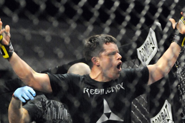 Specialist John McDonald, who represented the Resiliency Campus, celebrates his welterweight championship win against Spc. Justin Jagusch during the 2011 Fort Hood Combatives Championships.