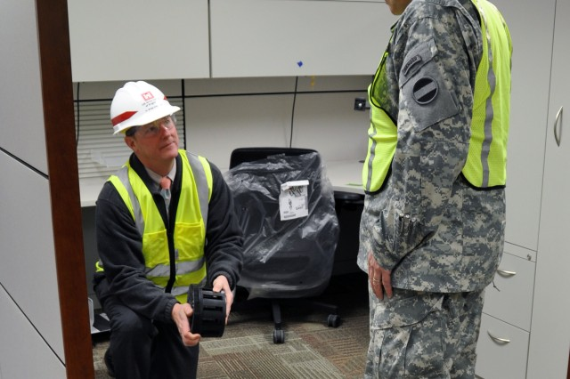 (FORT BRAGG, N.C., Feb. 3, 2011) - Ted Kientz, FORSCOM LNO, demonstrates HVAC innovations built into the new FORSCOM/USARC Combined Headquarters to Command Sgt. Maj. Ronald T. Riling, FORSCOM command sergeant major. Riling spent three days here being updated on the status of preparations to receive FORSCOM's personnel over the next several months.