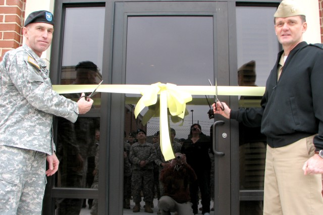 Col. Anthony Stratton (left), commander, Theater Support Command, Military Intelligence Readiness Command, Fort Belvoir, Va., and Navy Capt. Gene Price, Naval Intelligence Readiness Reserve Southeast commander, cut the ribbon to officially open the 8,000-square-foot addition to the Southeastern Army Reserve Intelligence Support Center (SEARISC), Bldg. 839 on Fort Gillem Jan. 20., The annex will provide the center with space for administrative support staff and training.