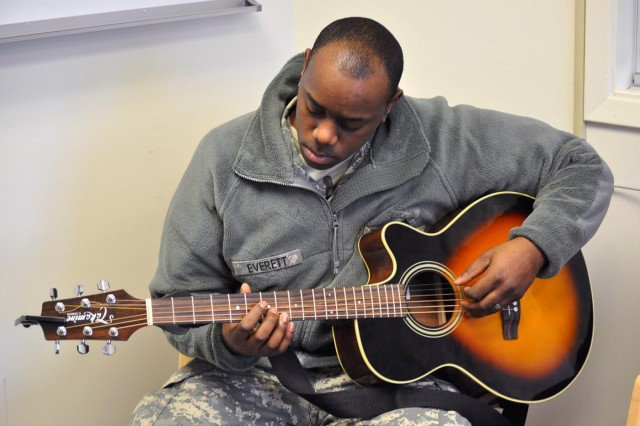 """The loss of a childhood friend several years ago inspired Pvt. 2 Christopher Everett to start writing songs, including """"My Prayer"""", which he performed at a memorial for Pfc. Amy Sinkler during a Jan. 28 memorial ceremony in the Joint Base Elmendorf-Richardson, Alaska, Soldiers' Chapel."""