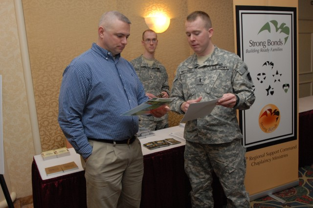 1Lt. Williams explains the Army Strong Bonds program with a Soldier during  the Yellow Ribbon Reintegration event at the Trump Plaza in Atlantic City, N.J. The program consists of seven events that take place at intervals before and after mobilization, which gives the Soldiers and Family members information, counseling, skills and techniques for upcoming deployments and re-deployments. For more information about the Yellow Ribbon Program please check out www.arfp.org (Photo by Sgt. 1st Class Alyn-Michael Macleod)