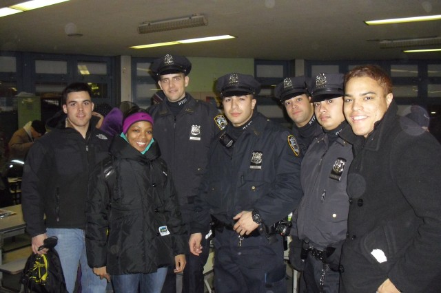 More than 60 West Point cadets join members of the New York Police Department during the HOPE event on Jan. 31 in New York City. The cadets, from left, are Cadets Charles Cannon and Kasandra Clark from the Class of 2011 and Cadet Miguel Moyeno, Class of 2012.