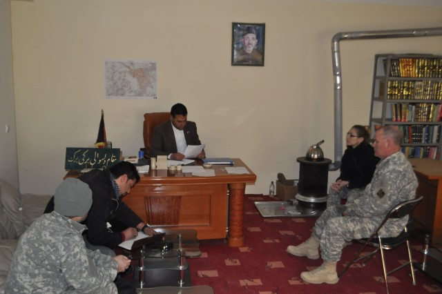 From Left, an Afghan translator; Ahmad Seyar Ziayeen, a U.S. Army Corps of Engineers (USACE) legal advisor in Afghanistan Engineer District-North (AED-N); Mohammad Rahim Amin, district sub-governor for Baraki Barak district of Logar Province; Marie Huber, district chief of capacity development for USACE in AED-N, of Jacksonville, Fla.; and U.S Army Reserve Lt. Col. David R. Staggs, Active Guard Reserve out of Fort Sill, Okla. and USACE officer in charge at Forward Operating Base Shank in AED-N, meet at the Baraki Barak district offices, Jan. 24. The group met to gather input and discuss a letter of support for proposed trade and vocational schools to be built in the district.