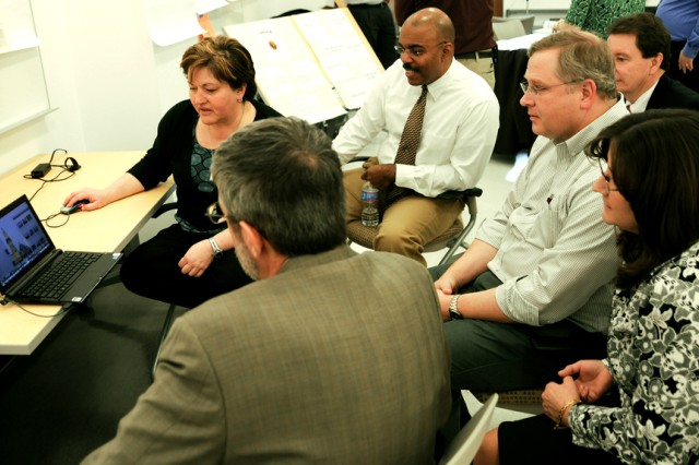 Aberdeen Proving Ground Leadership Cohort participants share thoughts with one another about the individual projects they have worked on throughout the year. The second APG Leadership Cohort graduation takes place at 3 p.m. today, Feb. 9, at the Mission Training Facility Auditorium.