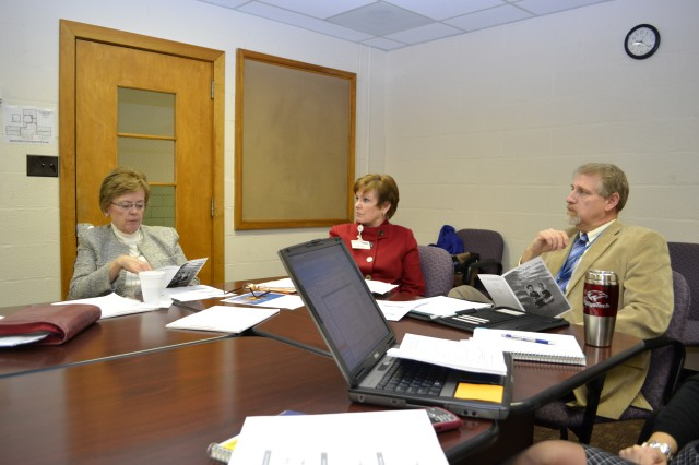 Elkton, Md. -- Georgia Wensell, Kathleen Kunda and Frank Cardo participate in a meeting of Cecil County STEM summer camp organizers on Jan 31.