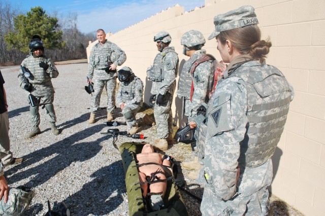 A contingency contracting team conducts an after-action review following its training session in the Fort Campbell, Ky., military operations in urban terrain facility.