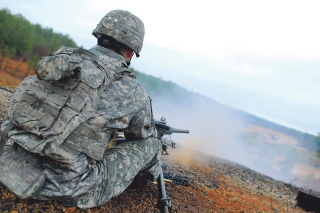 Staff Sgt. Lathan Forristall, of 4th Brigade Combat Team, 2nd Infantry Division, fires a .50-caliber machine gun Friday at Patton Range. The Infantry Advanced Leader Course students are entering their final week of training.