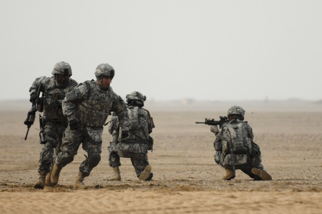 CAMP BUEHRING, Kuwait - Soldiers with Headquarters and Headquarters Troop, 3rd Advise and Assist Brigade, 1st Cavalry Division react during an exercise, Feb. 8, designed to prepare personal security detachments for missions while deployed.