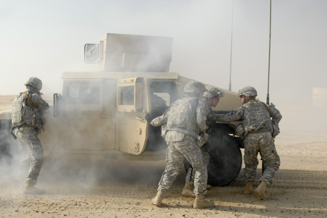 CAMP BEUHRING, Kuwait - Soldiers with personal security detachment, Headquarters and Headquarters Troop, 3rd Advise and Assist Brigade, 1st Cavalry Division react to a downed vehicle and hostile contact during a training event Feb. 8 at Camp Buehring, Kuwait.