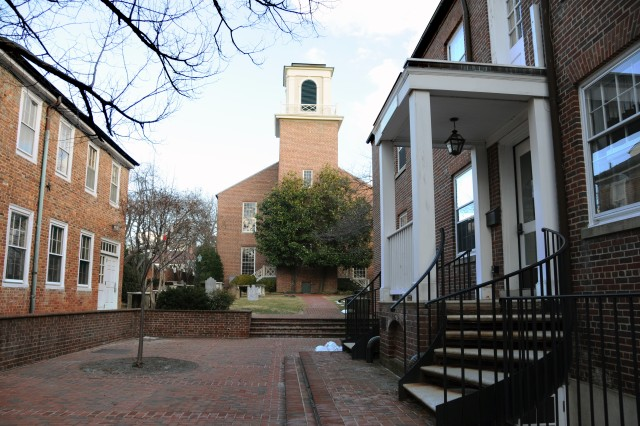 The Old Presbyterian Meeting House in the rear, is flanked by the Pastor's home on the left with the churchyard burial ground between the two.