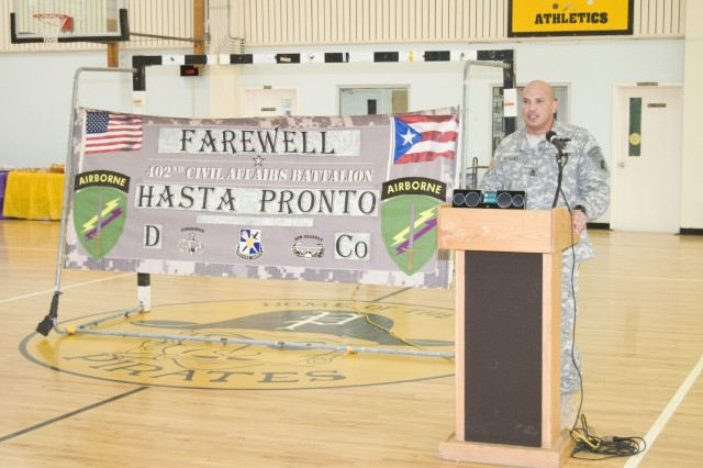 Sgt. 1st Class Luis Robles, speaks to the families of Company D, 402nd Civil Affairs Battalion Soldiers during the unit's farewell ceremony Jan. 21. The Soldiers traveled to Fort Dix, N.J. where they are currently preparing for their mission with the Combined Joint Taskforce Horn of Africa.