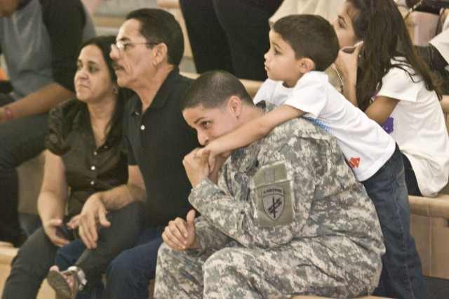 Civil Affairs Specialist, Spc. Luis Torres and his son, Ethan, share a tender moment just before the start of Company D's going away ceremony Jan. 21.
