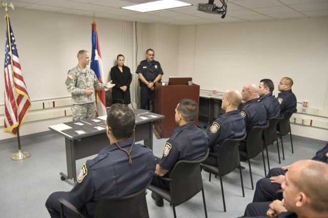 Col. John D. Cushman, commander of U.S. Army Garrison Fort Buchanan, speaks to the newest class of Department of the Army Security Guards during the recruits' graduation ceremony at Fort Buchanan, Feb. 9