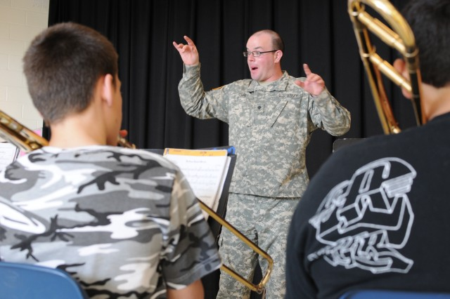 FORSCOM band coaches students while performing its community outreach mission