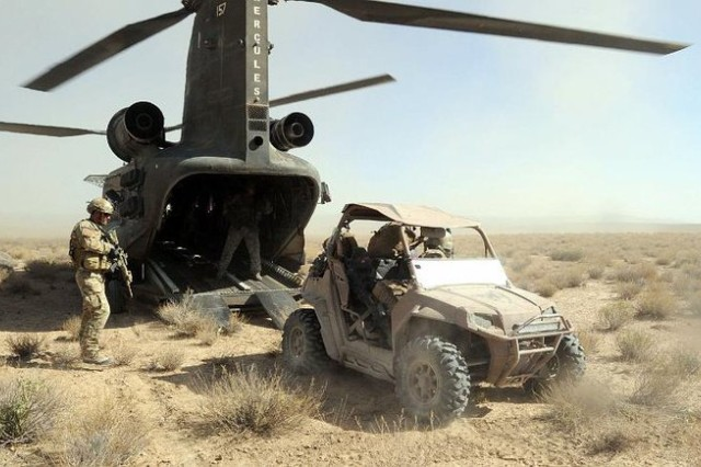 Special Forces Soldiers load ATV onto Chinook