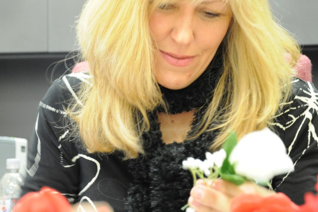Beverly Metcalfe, who works with Child, Youth and School Services, makes boutonnieres and corsages for Saturday's Sweetheart Ball.