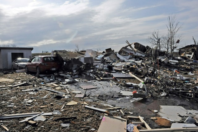 Debris and rubble were all that remained after a severely destructive tornado ripped through Fort Leonard Wood, Mo., on New Year's Eve. Four Fort Sill claims volunteers traveled there to lend a hand and learn procedures for handling claims resulting from a disaster.