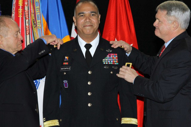 Maj. Gen. Anthony G. Crutchfield, commanding general of the U.S. Army Aviation Center of Excellence and Fort Rucker, gets his new rank pinned on by his father-in-law, Donald Adkins, and his mentor, retired Lt. Gen. Thomas Metz, during a Feb. 3 ceremony at the U.S. Army Aviation Museum on the post.
