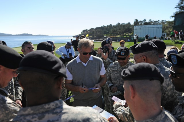 PEBBLE BEACH, Calif. - Actor Kevin Costner signs autographs and speaks with service members after the 3M Celebrity Challenge at Pebble Beach. The celebrity challenge was part of the weeklong AT&T Pebble Beach Pro-Am and benefits local charities. Feb. 9 was Military Day at the tournament.