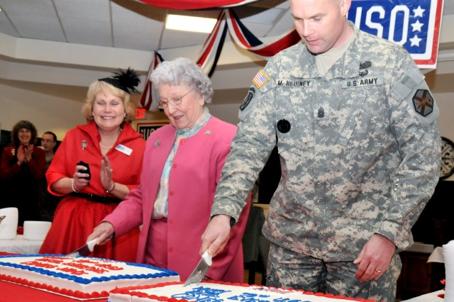 Mary Parry, center, kicks off the USO's 70th anniversary celebration Friday at the organization's Fort Drum location alongside Garrison Command Sgt. Maj. John McNeirney and Karen Clark, USO Fort Drum director.  Parry has been a USO volunteer since the organization formed in 1941.