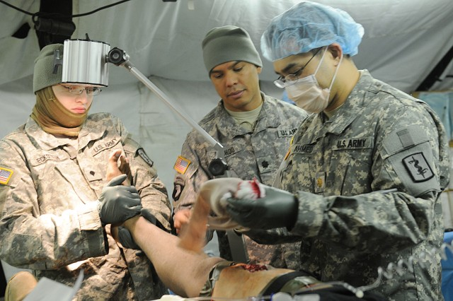 Soldiers of the 212th Combat Support Hospital treat a simulated casualty in the operating room of the 10-bed early entry package Feb. 8, in Miesau, Germany.