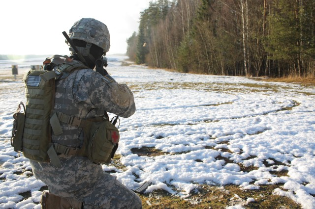 Sgt. Brandon Vergien, an 18th Engineer Brigade personal security detachment team leader from East Aurora, N.Y., qualifies with his M4 rifle during a qualification range in Grafenwoehr, Germany, Jan. 20.
