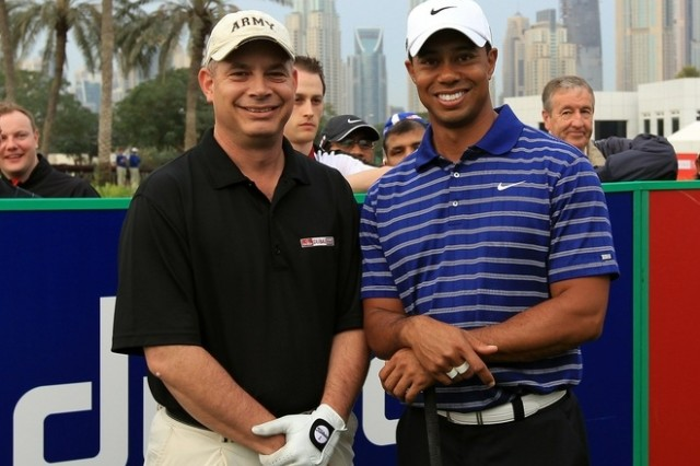 Lt. Col. Michael Rowells of the Army Sustainment Command's 401st Army Field Support Brigade poses with Tiger Woods before the Omega Dubai Desert Classic Pro-Am tournament at the Emirates Golf Club on February 9. Rowells was among 16,000 amateur golfers who entered an online contest and was picked to play in a foursome with the world's third-ranked golfer. (Courtesy photo)