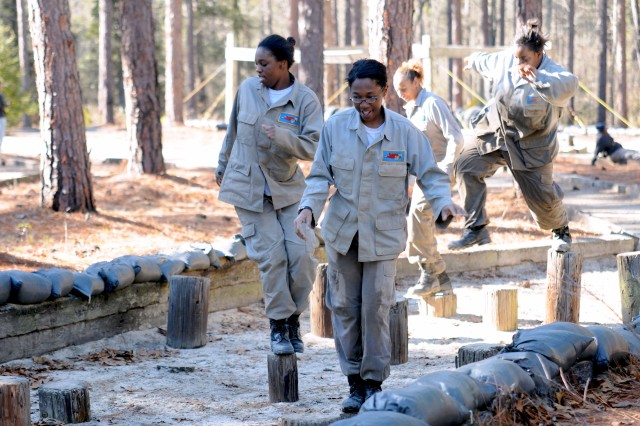 """Cadets with Tarheel Challenge Academy make a clean sweep of the """"Dirty Name,"""" one of 28 obstacles designed to test Soldiers in the Pre-Ranger Course. The North Carolina program, devoted to high school dropouts, visited Fort Bragg for one week in January."""