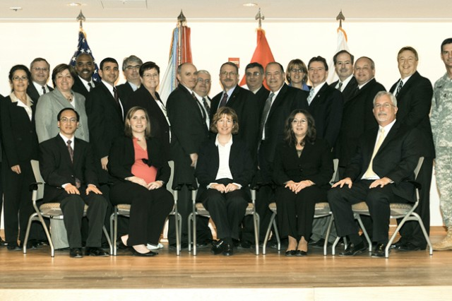 Twenty-nine managers representing 14 APG organizations received Senior Leader Cohort Program coins at their graduation ceremony Feb. 9. The cohort participants committed a year ago to participate in a unique professional development program designed to develop APG civilian leaders.
