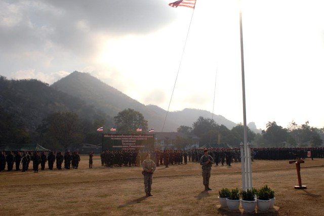 Soldiers raise the American flag at an opening ceremony for Exercise Cobra Gold 2011 at Camp Erawan. Cobra Gold is a regularly scheduled joint and coalition multinational exercise hosted annually by the Kingdom of Thailand. Cobra Gold 2011 is the latest in a continuing series of exercises designed to promote regional peace and security.