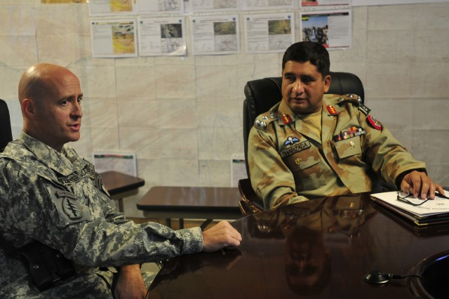 SPIN BOLDAK, Afghanistan - U.S. Army Col. Robert Waltemeyer, (left) Joint Border Coordination Center director speaks with Pakistan Army Brig. Gen. Asad Shahzada, Pishin Scouts and Frontier Corps zone commander. Liaisons from the Pakistan Army, Afghan National Security Forces and International Security Assistance Force officials met to discuss improving border relations along the Afghan-Pakistan border. The trilateral partnership discussed issues ranging from fighting terrorist activities and improving information sharing to upgrading roads. (U.S. Army photo by Sgt. Richard Andrade / 16th Mobile Public Affairs Detachment)