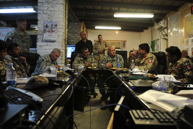 SPIN BOLDAK, Afghanistan - Pakistani Army Brig. Gen. Asad Shahzada (second from right) Pishin Scouts and Frontier Corps zone commander, talks to liaisons from the Afghan National Security Forces and International Security Assistance Force officials at the Joint Border Coordination Center on Forward Operating Base Spin Boldak. The meeting focused on improving border relations along the Afghan-Pakistan border. The trilateral meeting covered topics ranging from fighting terrorist activities and improving information sharing to upgrading roads. (U.S. Army photo by Sgt. Richard Andrade / 16th Mobile Public Affairs Detachment)