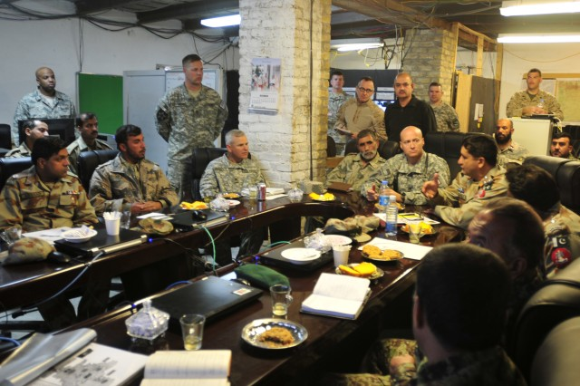 SPIN BOLDAK, Afghanistan - Pakistani Army Brig. Gen. Asad Shahzada (second from right) Pishin Scouts and Frontier Corps zone commander, gestures as he talks to liaisons from the Afghan National Security Forces and International Security Assistance Force officials at the Joint Border Coordination Center on Forward Operating Base Spin Boldak. The trilateral meeting covered topics ranging from fighting terrorist activities and improving information sharing to upgrading roads. (U.S. Army photo by Sgt. Richard Andrade / 16th Mobile Public Affairs Detachment)