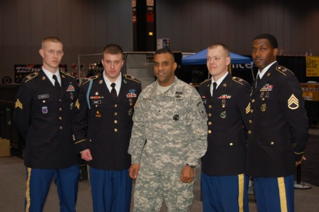 USAREC DCG, Brig. Gen. Bryan Roberts, with his Homewood, Ill. Recruiting Station Soldiers after the PaYS Signing at the 2011 Chicago Auto Show.