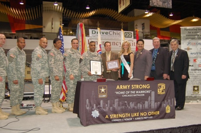 From left to right: Lt. Col Brian Bassett, Chi Rec. Bn CDR; 1st Lt. Victor Mitchell; 1st Sgt. John Delk; Command Sgt. Maj. Renee Dozier; Master Sgt. William Rivera; Brig. Gen. Bryan Roberts, USAREC DCG; Itasca Mayor Jeff Pruyn; 'Miss Illinois,' Whitney Thorpe Klinsky; Marcelino Morales, Hispanic Marketing Analyst, PaYS; Officer Rick Brogan, Itasca Police and Dan Kompanowski - Village of Itasca.