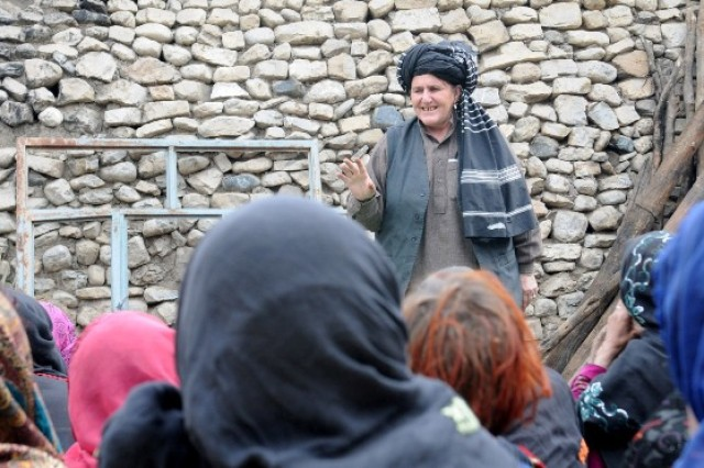Hakmina, a female provincial council member, addresses local women at a women's shura held in Jaji Maidan, Afghanistan, Feb. 10. She attended the first women's shura held in the area to discuss challenges and issues the women were having. The meeting helped initiate dialogue between the women of Jaji Maidan and their government.