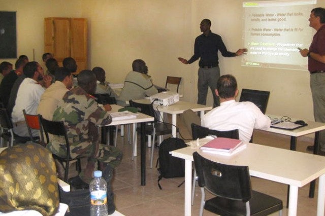 Maj. Michael Fuller (right), 3rd MDSC, makes a presentation to Mauritanian Medical Services soldiers with the help of a translator in Nouakchott, Jan. 19, 2011.