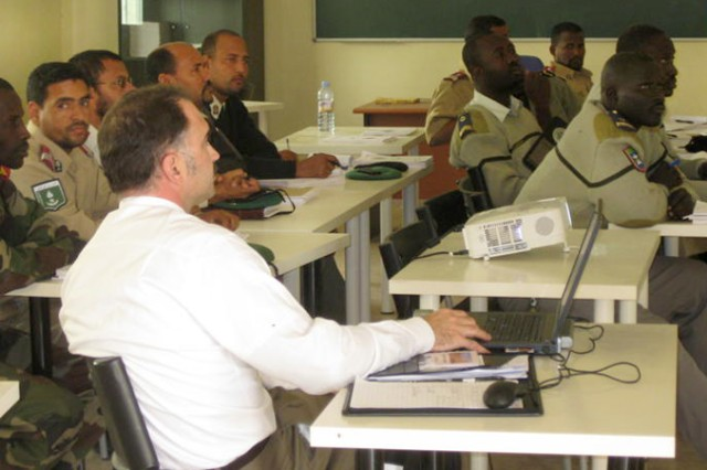 Lt. Col. Tim Doherty (foreground), 3rd MDSC, makes a presentation to Mauritanian Medical Services soldiers in Nouakchott, Jan. 16, 2011.