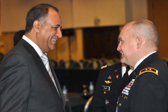 U.S. Army Africa Commander, Maj. Gen. David R. Hogg (right), speaks with Prof. Mohammed Benhammou of the African Federation of Strategic Studies, host and moderator of the Marrakech Security Forum in Marrakech, Morocco, Jan. 20.