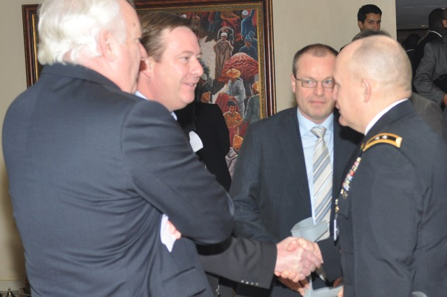 U.S. Army Africa Commander, Maj. Gen. David R. Hogg, greets Belgian delegates to the Marrakech Security Forum in Marrakech, Morocco, Jan. 20.