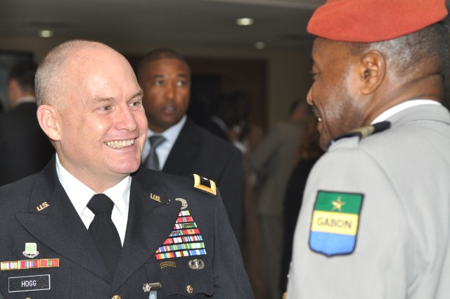 U.S. Army Africa Commander, Maj. Gen. David R. Hogg, greets Lt. Col. Jean Bernard Nguema-Bilong of Gabon at the opening of the Marrakech Security Forum in Marrakech, Morocco, Jan. 20.
