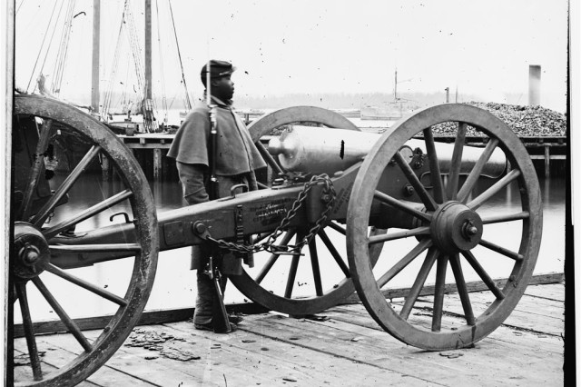 (Unknown location) Soldier guards 12-pounder Napoleon.