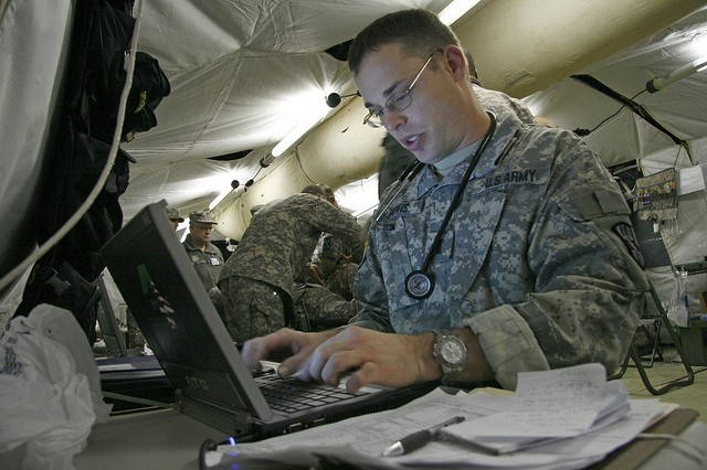 1st Lt. Christopher Jarvis, nurse with the 256th Combat Support Hospital, uses the MC4 system to electronically capture data on a mass casualty victim during pre-deployment training at Joint Base Lewis-McChord, Wash.