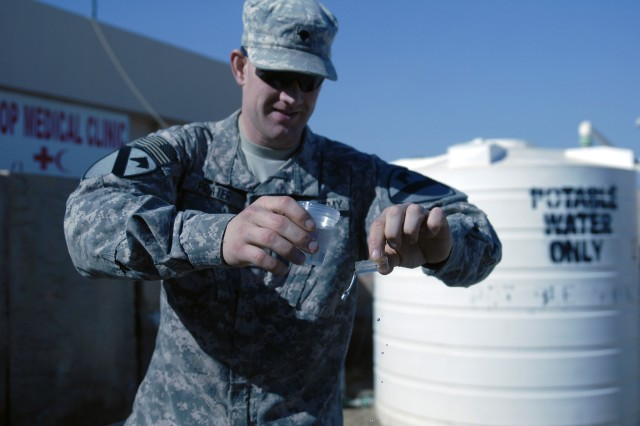 CONTINGENCY OPERATING SITE MAREZ, Iraq - Spc. Nyan Prater, a preventive medicine specialist assigned to Company C, 27th Brigade Support Battalion, 4th Advise and Assist Brigade, 1st Cavalry Division, and a native of San Diego, prepares to test a water sample at the battalion's troop medical clinic on Contingency Operating Site Marez, Feb. 12, 2011. Prater has been on more than 50 patrols in the last four month to ensure Soldiers and Iraqi Security Forces stays healthy while deployed in support of Operation New Dawn.