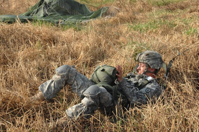 Spc. Brandon Mellott, of 3rd Battalion, 509th Parachute Infantry Regiment, removes himself from his T-10 Delta parachute harness after a U.S.-Thai airborne skill badge exchange jump Feb. 9 at Tadia Drop Zone, Thailand, during exercise Cobra Gold 2011.